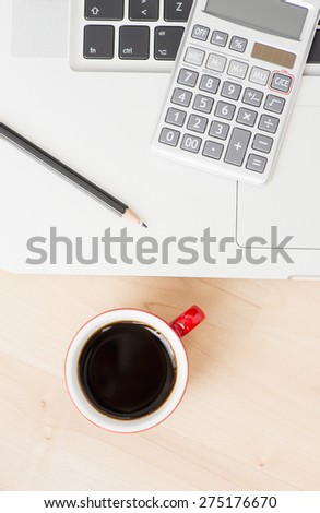 Office equipment at workplace. Desktop with laptop. Conceptual image of desk work, communication technology and business.