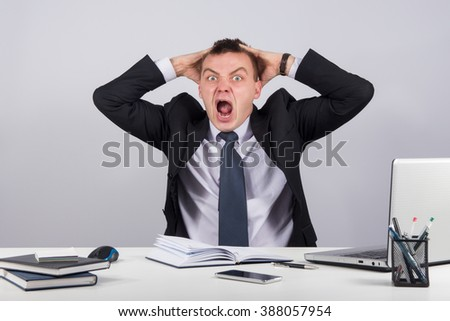 Office, finances, internet, business, success and people concept-Angry businessman shouting in office on gray background - stock photo