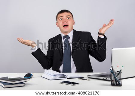 Office, finances, internet, business, success and people concept-Shocked businessman in panic  on gray background - stock photo