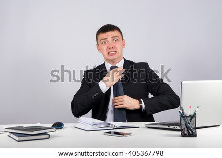 Office, finances, internet, business, success and stress concept-Frustrated businessman screams and pulls at his tie - stock photo