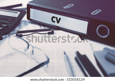 Office folder with inscription CV - Curriculum Vitae - on Office Desktop with Office Supplies. Business Concept on Blurred Background. Toned Image. - stock photo