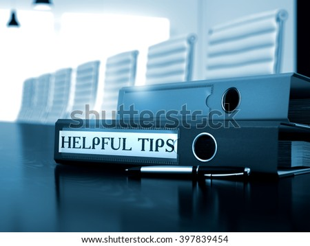 Office Folder with Inscription Helpful Tips on Desktop. Helpful Tips - Business Concept on Blurred Background. 3D Render. Toned Image.  - stock photo