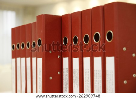 Office folders organized in a row. - stock photo