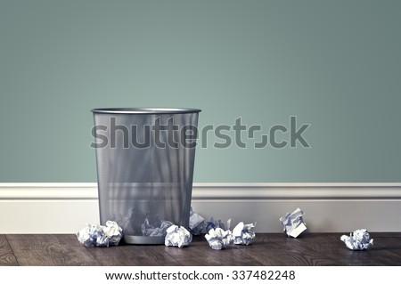 office garbage near metal basket - stock photo