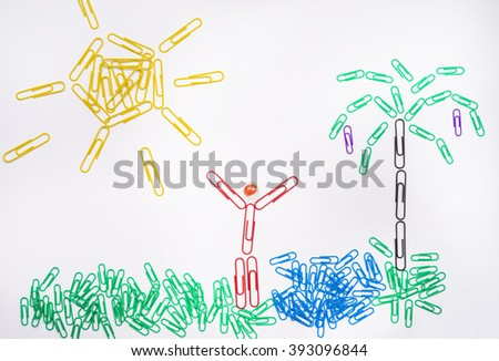 Office happiness concept - happy oasis made of paper clips - stock photo