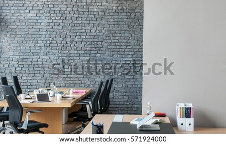corporate office interior. office interior behind brick wall corporate