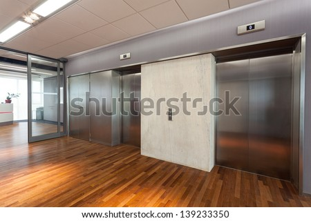 Office interior, hall with two elevators - stock photo