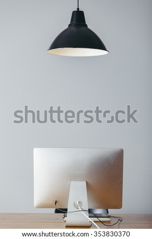 office interior with a lamp and a computer on wooden desk - stock photo