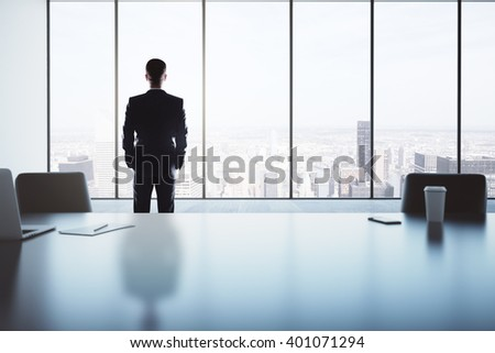 Office interior with businessman standing next to window with city view. 3D Rendering