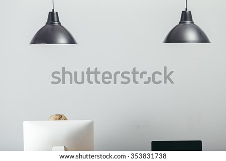 office interior with computers and two black lamps - stock photo