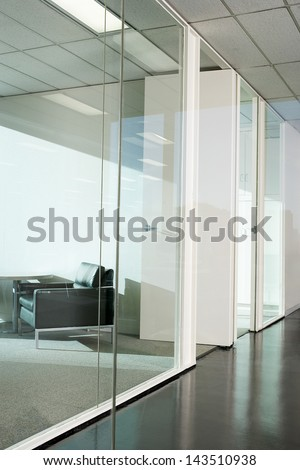 Office interior with glass partition - stock photo
