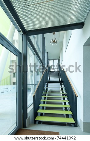 Office interior with modern stairs - stock photo