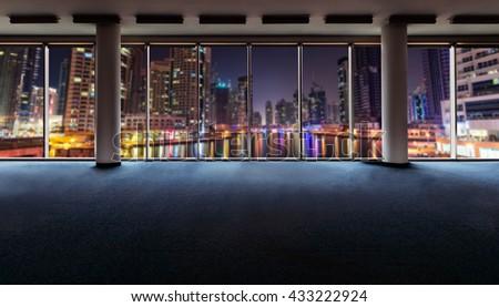 Office interior with panoramic windows revealing Dubai cityscape - stock photo