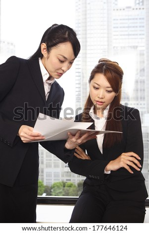Office Japanese Lady in the meeting while watching the material - stock photo