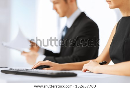 office, law and legal concept - business team on meeting using computer - stock photo