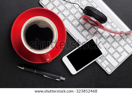 Office leather desk table with coffee cup, computer, smartphone and headphones. Top view - stock photo