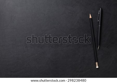 Office leather desk table with pen and pencil. Top view with copy space - stock photo
