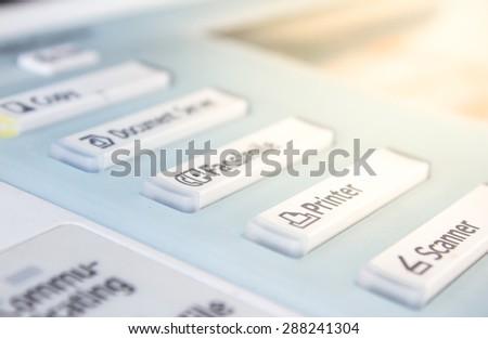 Office life, fax, copy machine under the golden sun, start button close up  - stock photo