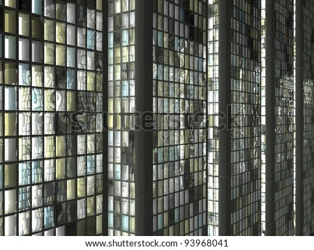 Office life: Skyscrapers with lighted windows at night - stock photo