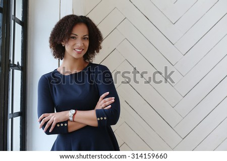 Office, lifestyle. Woman with African-American hairstyle - stock photo