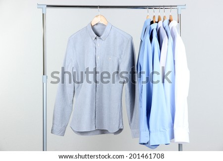 Office male clothes on hangers, on gray background - stock photo
