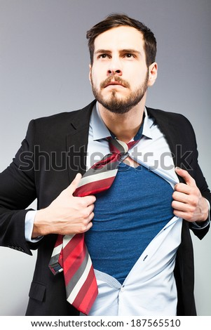 office man acting like superman - stock photo