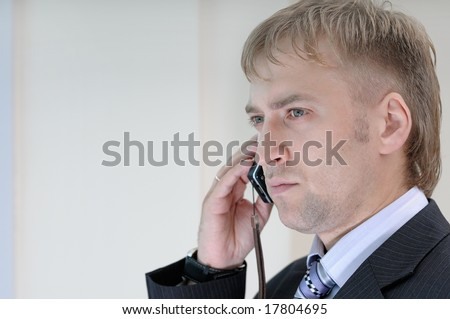 office manager talking by mobile phone - stock photo