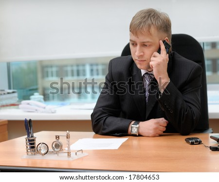 office manager talking by telephone - stock photo