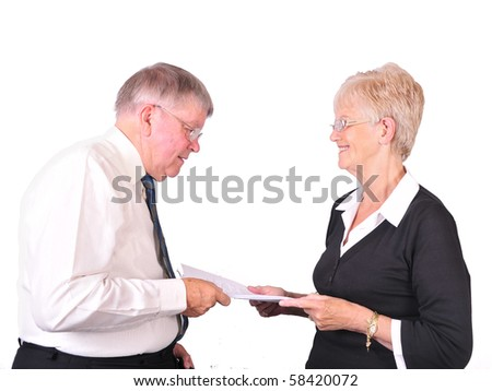 Office manager with secretary handing over notes