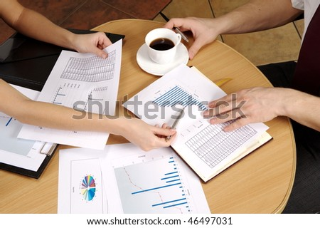 Office. Meeting On Business. Documents on the table. Business call. Team work to late hours.