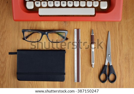 Office Objects And Typewriter On Wooden Table. Flat Lay
