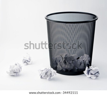 Office paper bin, trash, studio image - stock photo