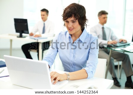 Office people being absorbed in their work - stock photo