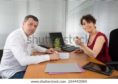 Office people. two employers working in team for the company success - stock photo