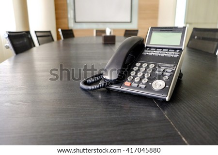 Office phone on table in meeting room