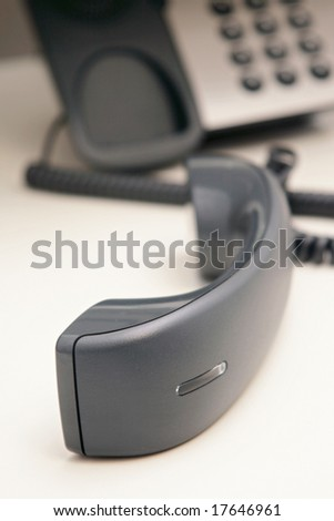 Office phone  on the desk.
