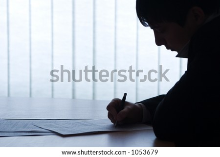 Office picture: contract and business man. Nice backlight and feeling, image is very clean, as always. - stock photo