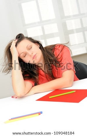 Office portrait of beautiful tired business woman sleeping at her workplace - stock photo