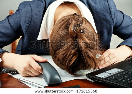 office portrait of beautiful young business woman sleeping at her workplace - stock photo