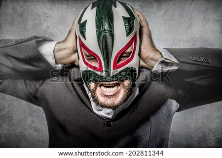 Office problems, aggressive executive suit and tie, Mexican wrestler mask - stock photo