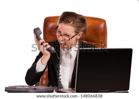 Office rage series - businesswoman received bad news over the phone and is screaming in rage - stock photo