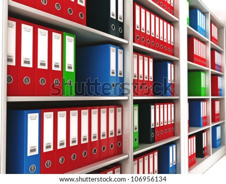Office ring binders on a bookshelf with depth of field