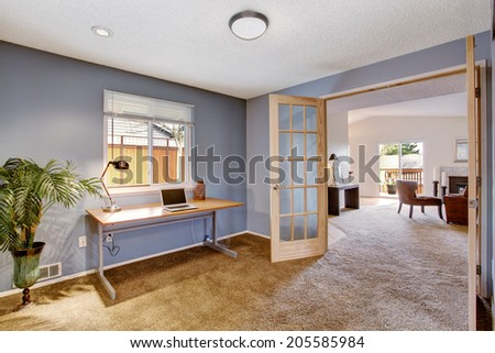 Office room interior in light lavender. Decorated with palm tree in the corner - stock photo