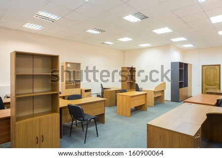 Office room with empty furniture