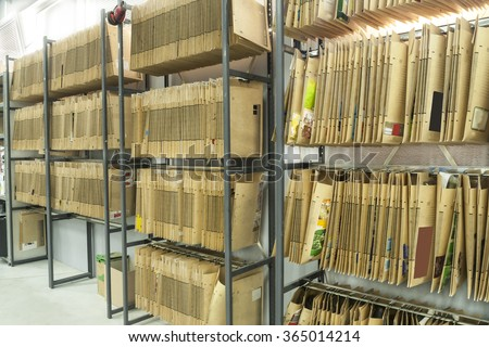 Office shelves full of files and boxes - stock photo