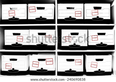 Office shelves with boxes of tax documents - stock photo