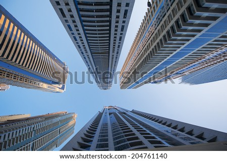 office skyscrapers on blue sky background - stock photo