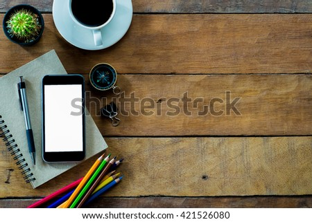 Office stuff with blank screen smartphone, coffee cup ,pen,pencil and notebook.Top view with copy space - stock photo