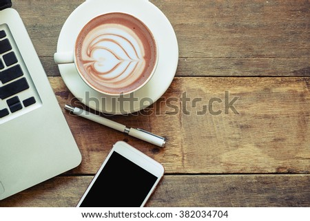office stuff with laptop smartphone and coffee cup mouse notepad top view shot. - stock photo