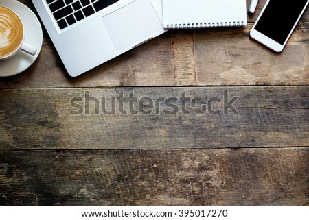 office stuff with smart phone laptop and coffee cup mouse notepad top view shot. - stock photo